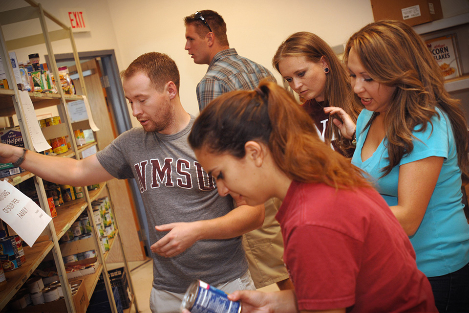 NMSU students volunteer at a local food bank.